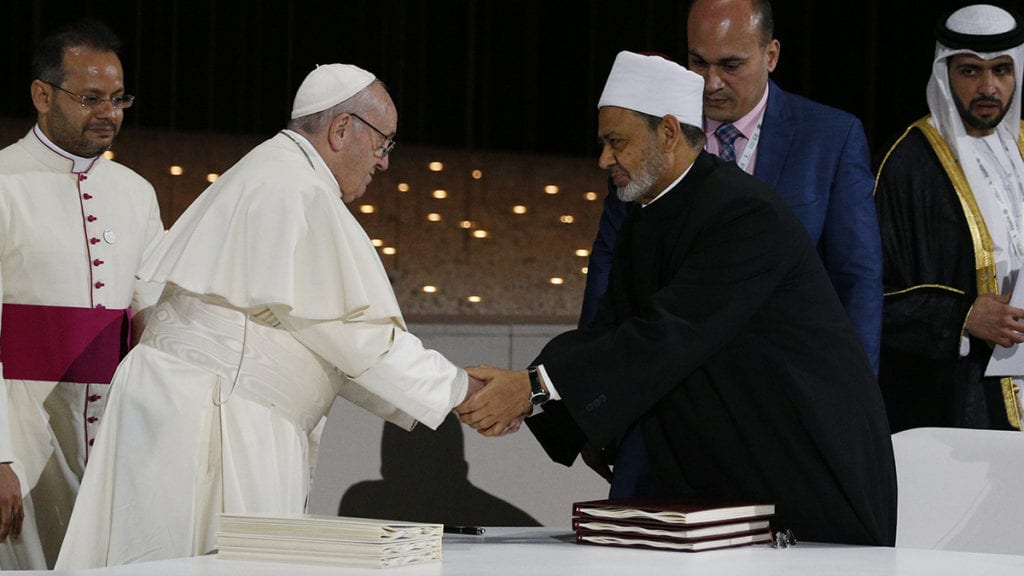 Pope Francis shakes hands with Sheik Ahmad el-Tayeb, grand imam of Egypt's al-Azhar mosque and university.